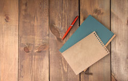 Blank vintage paper sheet and notebook with pen Royalty Free Stock Photo