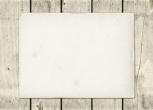 Blank vintage paper sheet on a white wood board Stock Photos