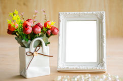 Blank vintage photo fame and flower. Royalty Free Stock Photo