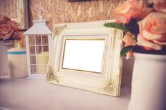 Blank vintage photo frame ,flower and Decoration on wooden backg Stock Photography