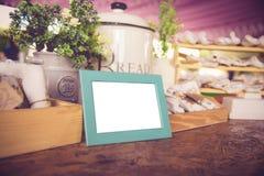 Blank vintage photo frame ,flower and Decoration on wooden background. Blank vintage photo frame ,flower and Decoration on wooden stock images