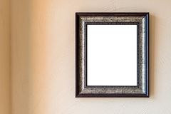 Blank vintage photo frame on wall Stock Photography