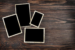 Blank vintage photo frames. On old wooden background. Clipping path included Stock Photos