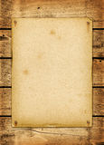Blank vintage poster nailed on a wood board Stock Photography