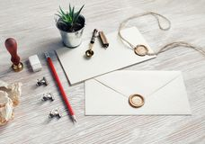 Blank vintage stationery. On light wood table background. Responsive design mock up royalty free stock photography