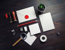 Blank vintage stationery. Set on wooden background. Responsive design mockup. Flat lay royalty free stock photography