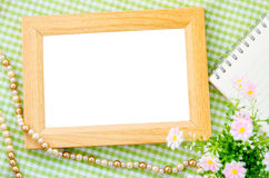Blank vintage wooden photo frame and open diary. Royalty Free Stock Image