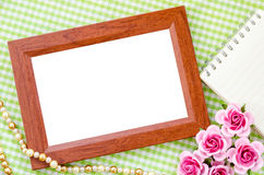 Blank vintage wooden photo frame and open diary Royalty Free Stock Photos