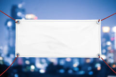 Blank vinyl banner. Blank white vinyl banner hanging with rope royalty free stock photography