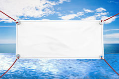 Blank vinyl banner. Blank white vinyl banner hanging with rope royalty free stock images