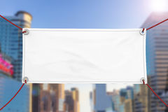Blank vinyl banner. Blank white vinyl banner hanging with rope royalty free stock photos