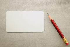 Blank visit card with pencil. On grunge background Stock Photography