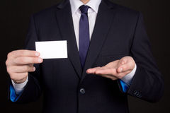 Blank visiting card in business man hand Royalty Free Stock Photography