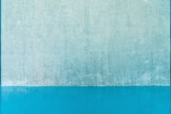 Blank wall and blue floor Royalty Free Stock Photos
