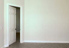 Blank wall with door stock photography