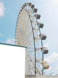 Blank wall and ferris wheel Stock Images