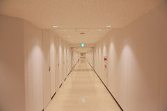 Blank wall and long walkway Royalty Free Stock Photography