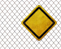 Blank warning sign at rusty fence Stock Images