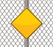 Blank warning sign on wire fence Royalty Free Stock Photography