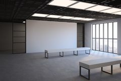 Blank whiite wall in loft hall. Side view on loft style empty exhibition white blank banner in gallery with white benches on concrete floor and floor-to-ceiling Stock Photos