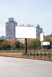 Blank white advertising banners near the road in autumn Stock Photography