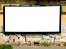 Blank white advertising billboard. On old facade Stock Photography