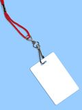 Blank white badge with copy space (+ clipping path). Blank white ID card / badge with copy space, on blue background. Contains clipping path of the card (without stock photo