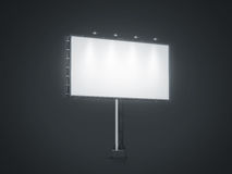Blank white banner mock up on city billboard at night. 3d rendering. Empty bill board mockup isolated. Clear light canvas on street sign. Large outdoor poster Stock Photography