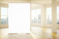 Blank white banner in room. Blank white banner in interior with wooden floor and city view. Mock up, 3D Rendering Stock Image
