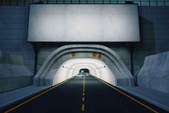 Blank white billboard above road tunnel at night Royalty Free Stock Image
