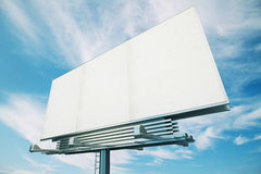 Blank white billboard on a background of blue sky Stock Photos