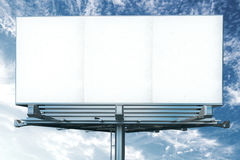 Blank white billboard on a background of blue sky Royalty Free Stock Photo