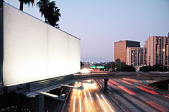 Blank white billboard on the background of the highway at evenin Stock Photography