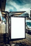 Blank billboard on the bus station. Blank white billboard on the bus station Royalty Free Stock Photography