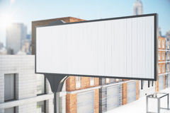 Blank white billboard on the city street Stock Images
