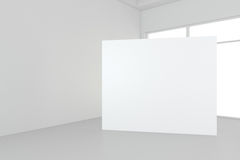 Blank white billboard in empty room with big windows, mock up, 3D Rendering Royalty Free Stock Images