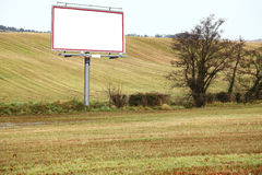 Blank white billboard in field Royalty Free Stock Photography