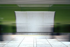 Blank white billboard on green wall in the subway with mooving p Stock Photo