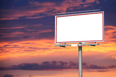 Blank white billboard over evening sky for your advertisement Stock Photography