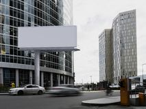 Blank white billboard with skyscrapers on background. 3d rendering stock image