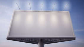 Blank white billboard standing in front of blue sky Stock Images