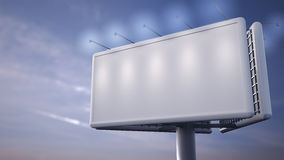 Blank white billboard standing in front of blue sky Royalty Free Stock Photo