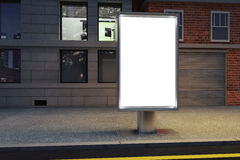 Blank white billboard on the street at night Royalty Free Stock Photo