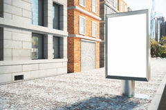 Blank white billboard on the street on a sunny day Stock Photography