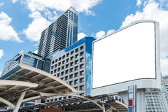 Blank white billboard on sunny city with building and blue sky. Royalty Free Stock Image