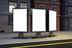 Blank white billboards on evening city street Royalty Free Stock Images