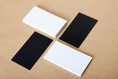 Blank white and black business cards crafts background. Royalty Free Stock Photo