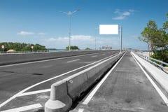 Blank White Blank board or billboard or roadsign in the street. Blank White Blank board or billboard or roadsign in the road under the bright blue sky stock photos