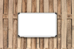 Blank white board on bamboo fence with sepia filter Royalty Free Stock Photos