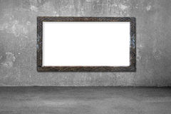 Blank white board with old dirty wooden frame on wall Royalty Free Stock Photo